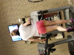 hot blond gal on threadmill running with thong