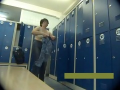 middle-aged mother strips in locker room