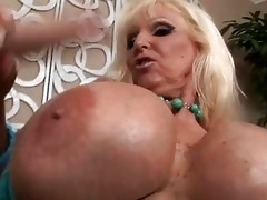tanned golden-haired with massive melons